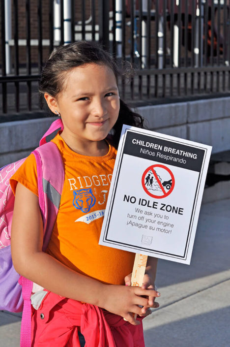 girl holding Be Idle Free Sign